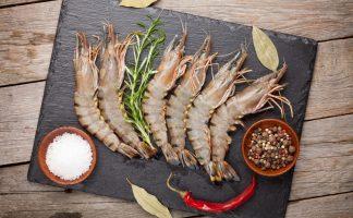 Fresh raw tiger prawns and spices